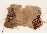 Textile fragment with blazons and inscription (EA1984.90)