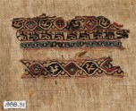 Textile fragment with interlacing roundels, birds, and pseudo-inscription (EA1988.51)