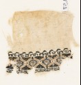 Textile fragment with pseudo-inscription border
