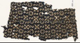 Textile fragment with reversed S-shapes, rosettes, and quatrefoils (EA1990.10)
