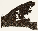 Textile fragment with rosettes and squares with crosses (EA1990.100)