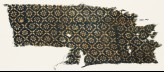 Textile fragment with flowers, dots, and rosettes (EA1990.107)