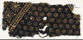 Textile fragment with rosettes and band with floral shapes (EA1990.121)