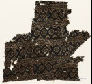 Textile fragment with rosettes, carnations, diamond-shapes, and crosses (EA1990.126)