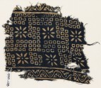 Textile fragment with bandhani, or tie-dye, imitation and rosettes