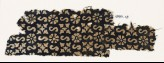 Textile fragment with S-shapes, rosettes, and quatrefoils (EA1990.13)