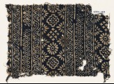 Textile fragment with carnations, stepped squares, stars, and rosettes (EA1990.130)