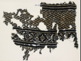 Textile fragment with linked chevrons and flowers, possibly from a garment