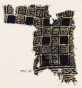 Textile fragment with linked squares, stylized flower-heads, and lines with dots (EA1990.142)