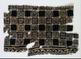 Textile fragment with linked squares, stylized flower-heads, and lines with dots (EA1990.143)