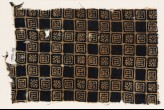 Textile fragment with linked squares, stylized flower-heads, and lines with dots (EA1990.145)