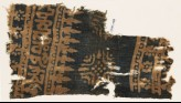 Textile fragment with Arabic-style script, rosettes, and stylized trees or foliage (EA1990.148)