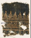 Textile fragment with inscription, rosettes, and stylized trees and palmettes