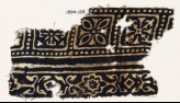 Textile fragment with squares, quatrefoils, and flowers (EA1990.154)
