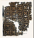 Textile fragment with S-shapes, rosettes, and quatrefoils (EA1990.16)