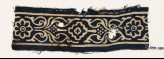 Textile fragment with rosettes, stylized leaves, and a diamond-shape (EA1990.168)
