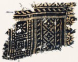 Textile fragment with diamond-shapes, and squares with rosettes (EA1990.210)