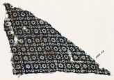 Textile fragment with S-shapes, circles, and stars