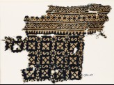 Textile fragment with S-shapes, rosettes, and quatrefoils (EA1990.24)
