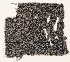 Textile fragment with elaborate rosettes, tendrils, and leaves