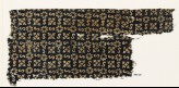 Textile fragment with S-shapes, rosettes, and quatrefoils (EA1990.26)