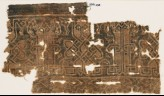 Textile fragment with interlace based on script, leaves, and tendrils (EA1990.273)