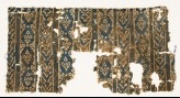 Textile fragment with bands of interlocking chevrons and linked medallions (EA1990.275)