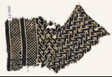 Textile fragment with linked chevrons, trefoils, and bands of dots (EA1990.37)