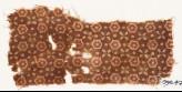 Textile fragment with stars, quatrefoils, and dots (EA1990.473)