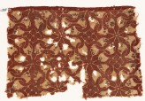 Textile fragment with interlocking spirals or rosettes (EA1990.509)