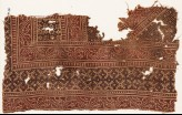 Textile fragment with bands of vines and serrated crosses