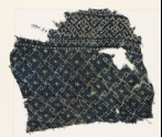 Textile fragment with rosettes and linked S-shapes made of dots