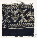 Textile fragment imitating bandhani, or tie-dye, with geometric patterns and arrow-shapes (EA1990.73)