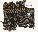 Textile fragment imitating bandhani, or tie-dye, with inverted hooks (EA1990.74)