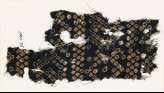 Textile fragment imitating bandhani, or tie-dye, with inverted hooks (EA1990.75)