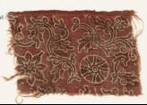Textile fragment with curving vines, quatrefoil, and rosette (EA1990.802)