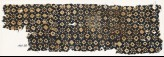 Textile fragment with rosettes, dots, and lobed squares (EA1990.88)