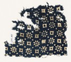 Textile fragment with rosettes, dots, and lobed squares (EA1990.89)