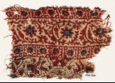 Textile fragment with vine and stars (EA1990.906)
