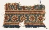Textile fragment with rosettes in circles (EA1990.921)
