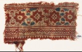 Textile fragment with flower-heads (EA1990.931)