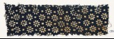 Textile fragment with rosettes and small squares (EA1990.94)