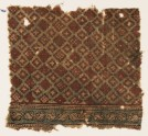 Textile fragment probably imitating patola pattern, with a grid of stepped diamond-shapes (EA1990.945)