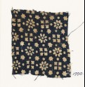Textile fragment with rosettes, stars, and squares (EA1990.95)