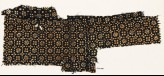 Textile fragment with flowers, rosettes, and squares (EA1990.98)