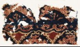 Textile fragment with tendrils and possibly leaves (EA1990.985)