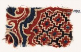 Textile fragment with stepped diamond-shapes and swirling plants (EA1990.988)