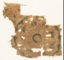 Textile fragment with part of a large rosette (EA1990.1001)