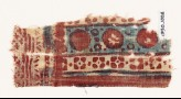 Textile fragment with circles and quatrefoils (EA1990.1008)