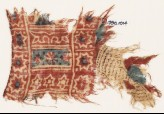 Textile fragment with stars, rosette, and crosses (EA1990.1014)